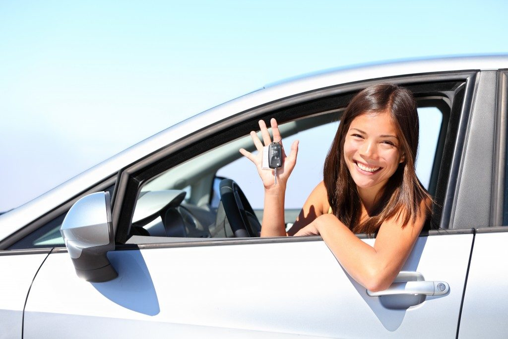 Woman with keys to her car