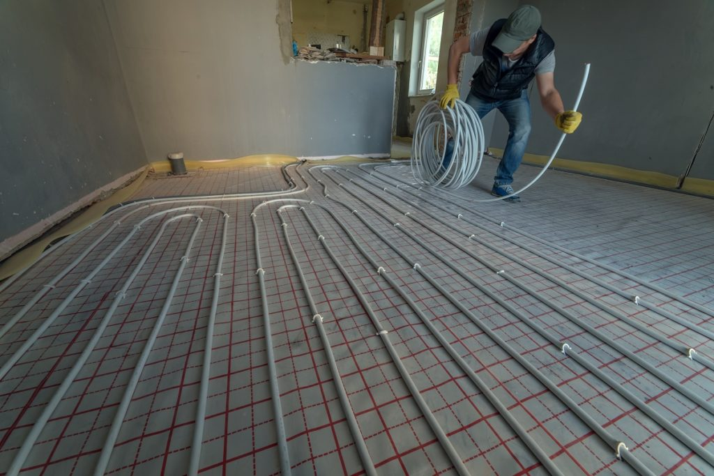 Floor radiant heating being installed