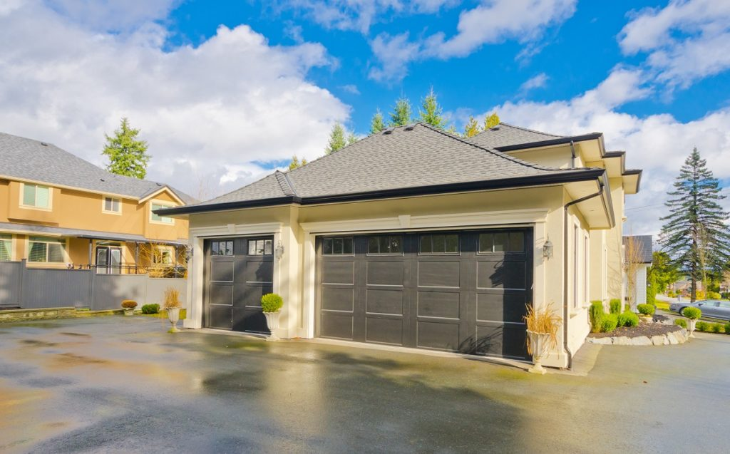 Home with asphalt driveway