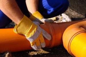 Workers replacing the sewer pipe
