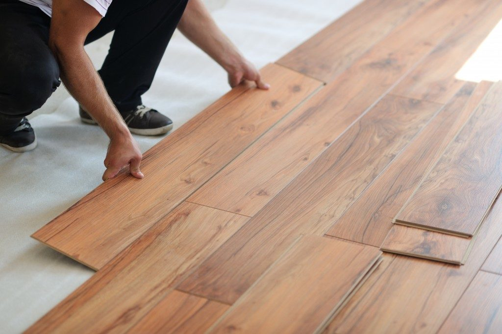 man attaching laminated floors