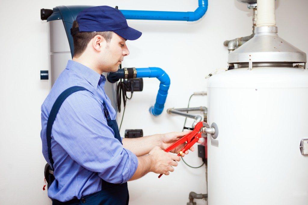 Plumber installing a water heater