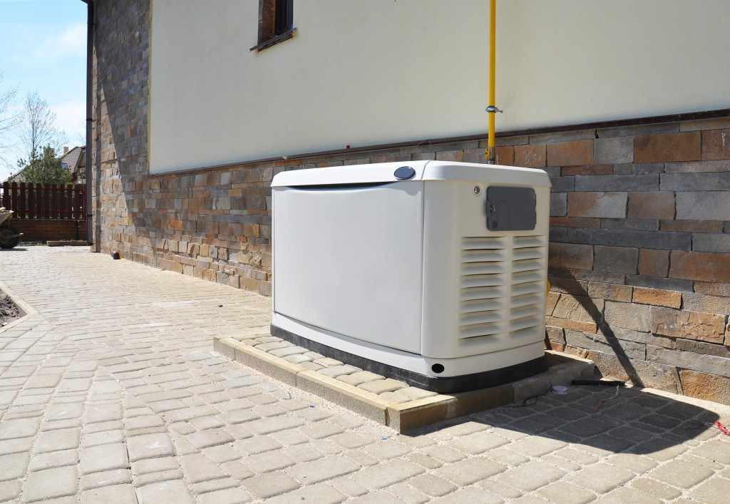 White generator beside a house
