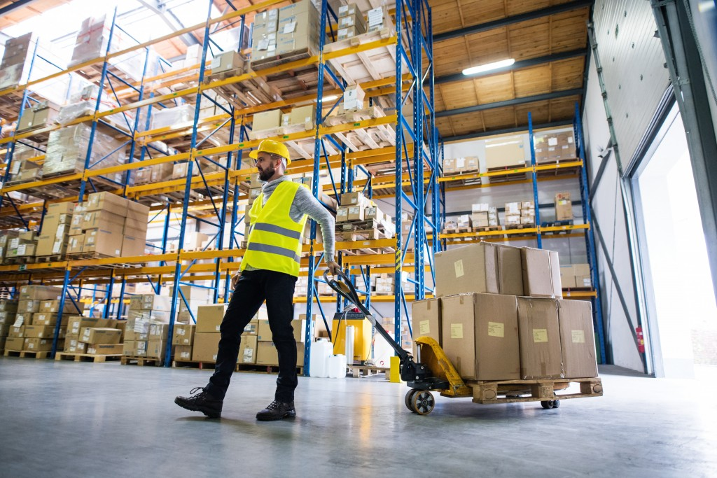 warehouse employee moving inventory