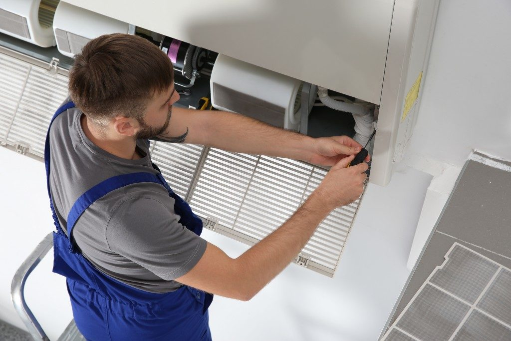 repairman fixing airconditioner