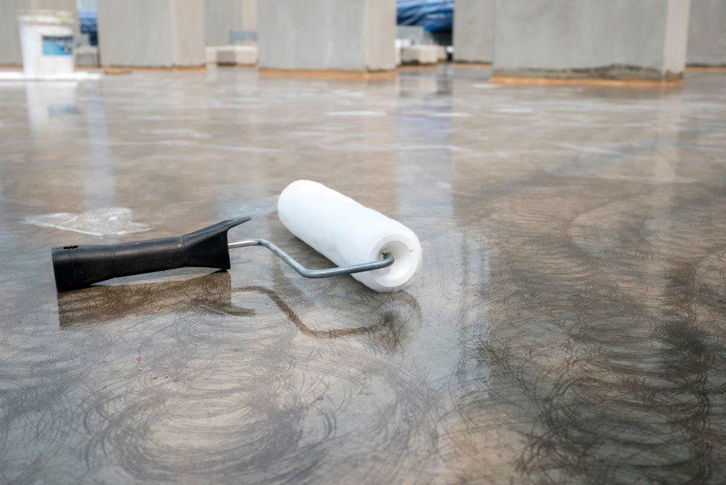 Water resistant coating concrete flooring