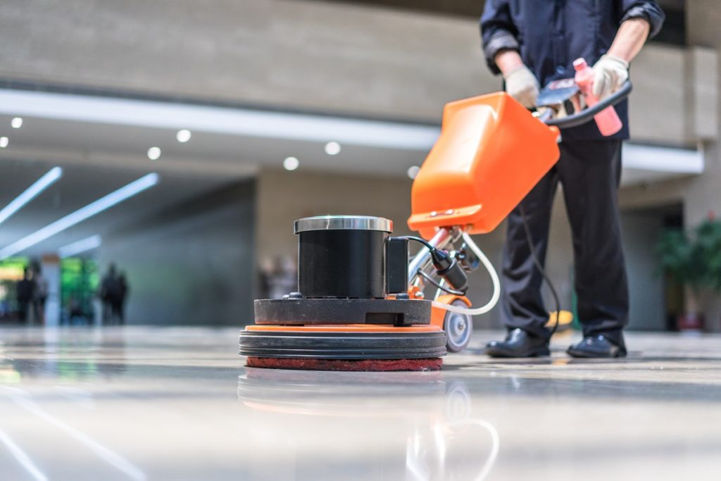Cleaning the floor using a machine