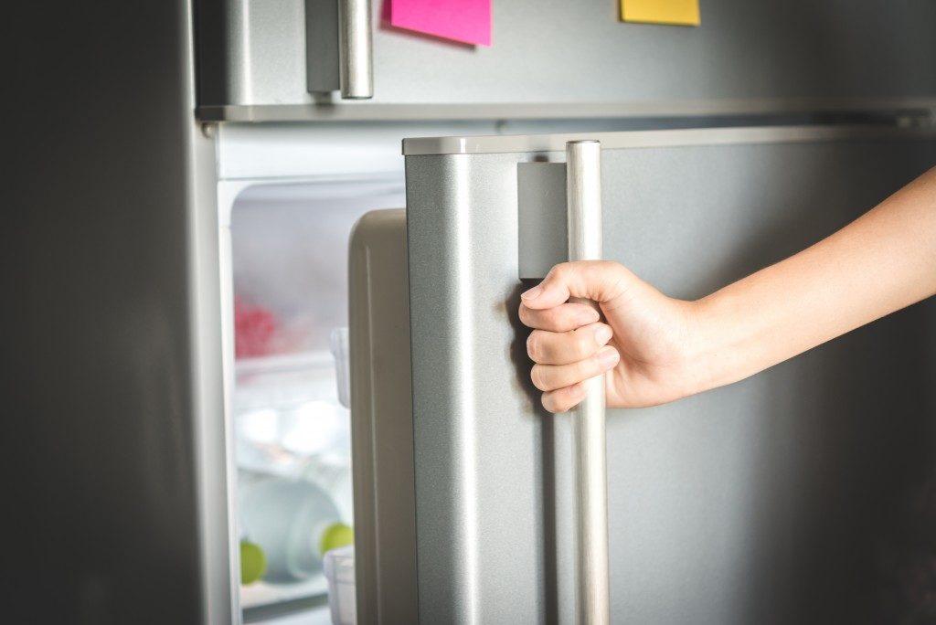 Opening a refrigerator door