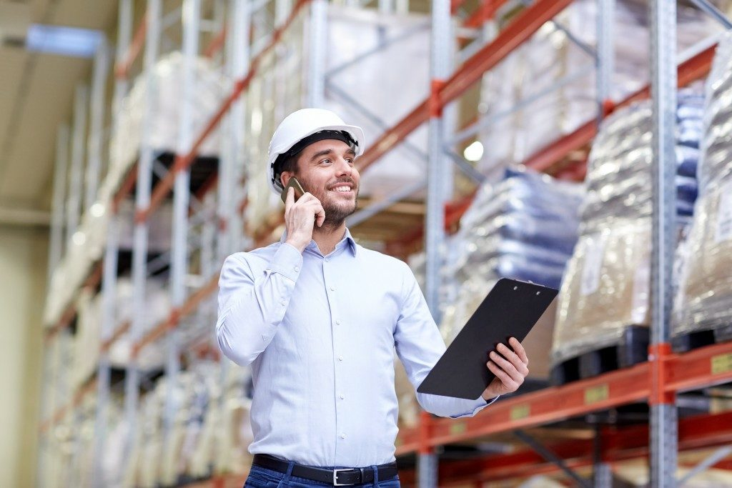 Man in warehouse talking on the phone