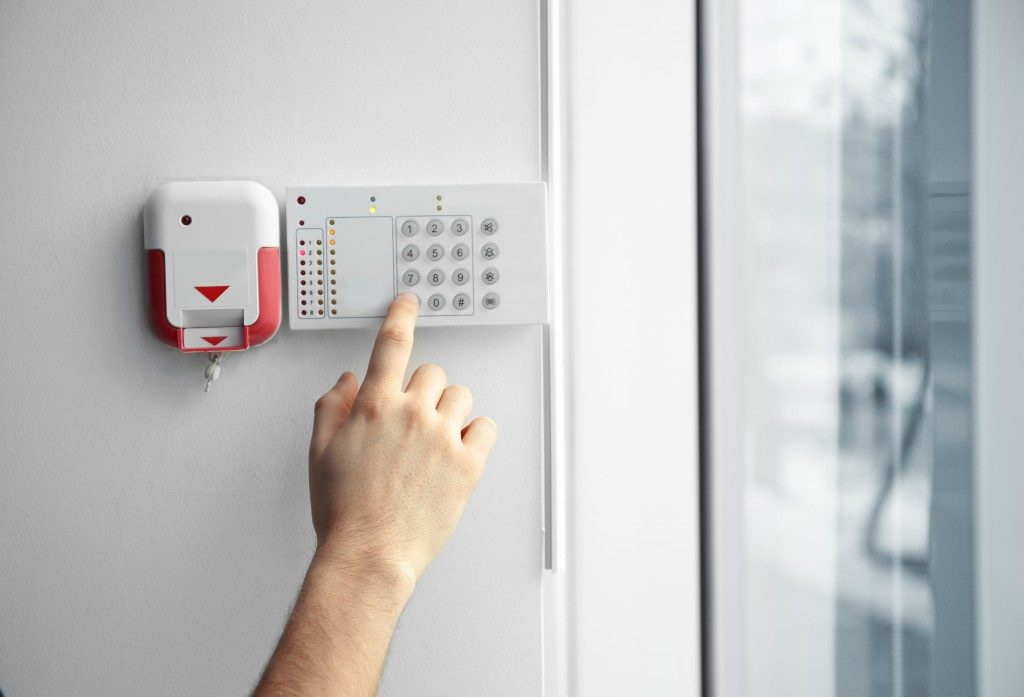 Security alarm keypad with male hand