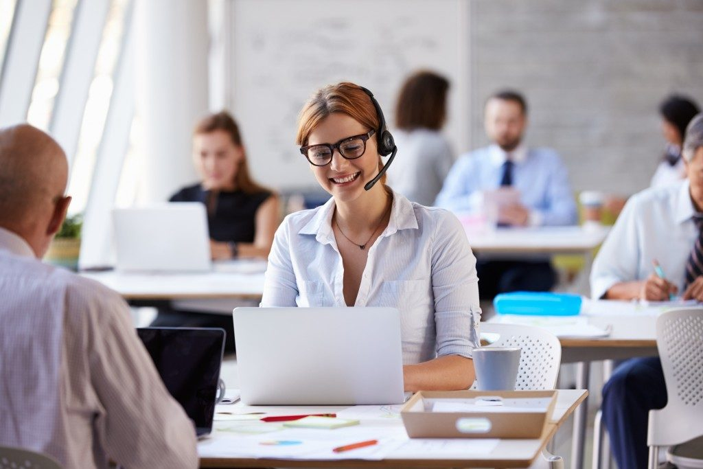 Businesswoman attending to customer service