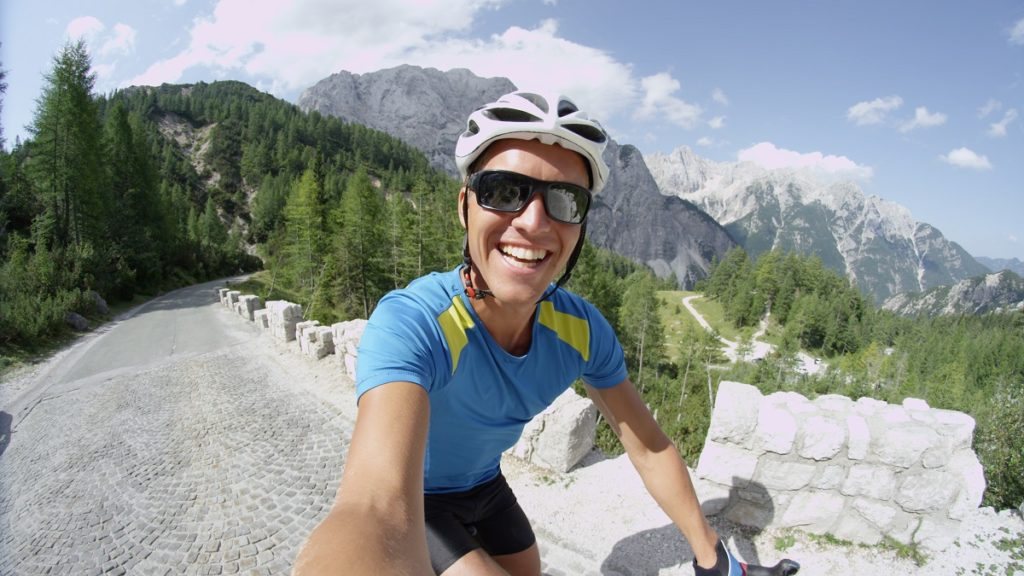 Man taking a selfie while riding his mountain bike