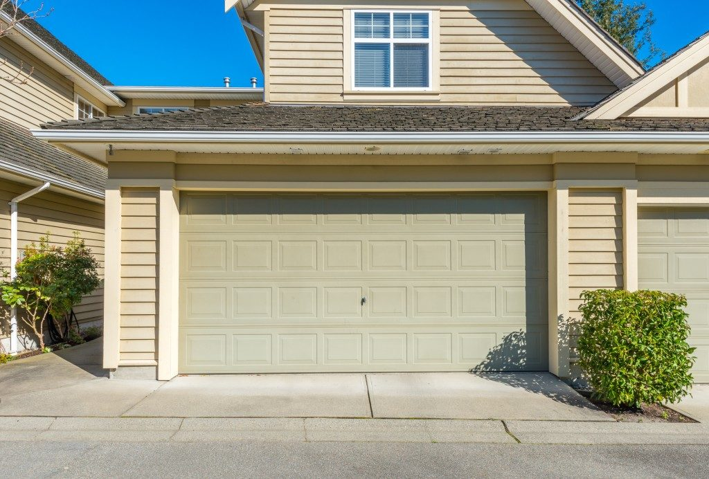 homes's garage with a green pale door color