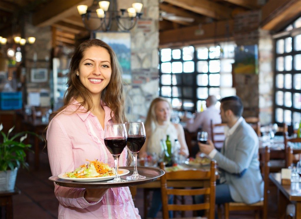 Woman serving food and wine