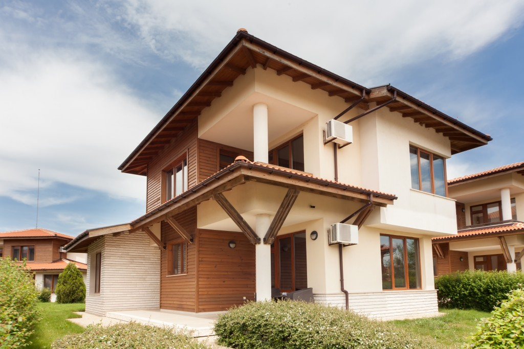 house apinted in cream colored and wood materials