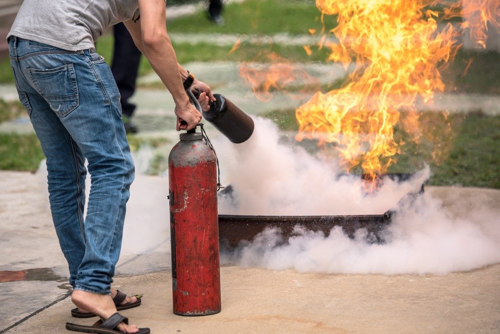 person taught to extinguish fire