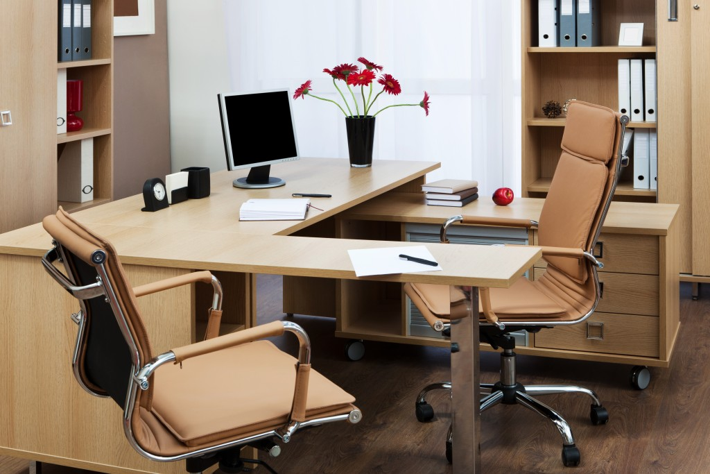 Clean office with chairs and monitor