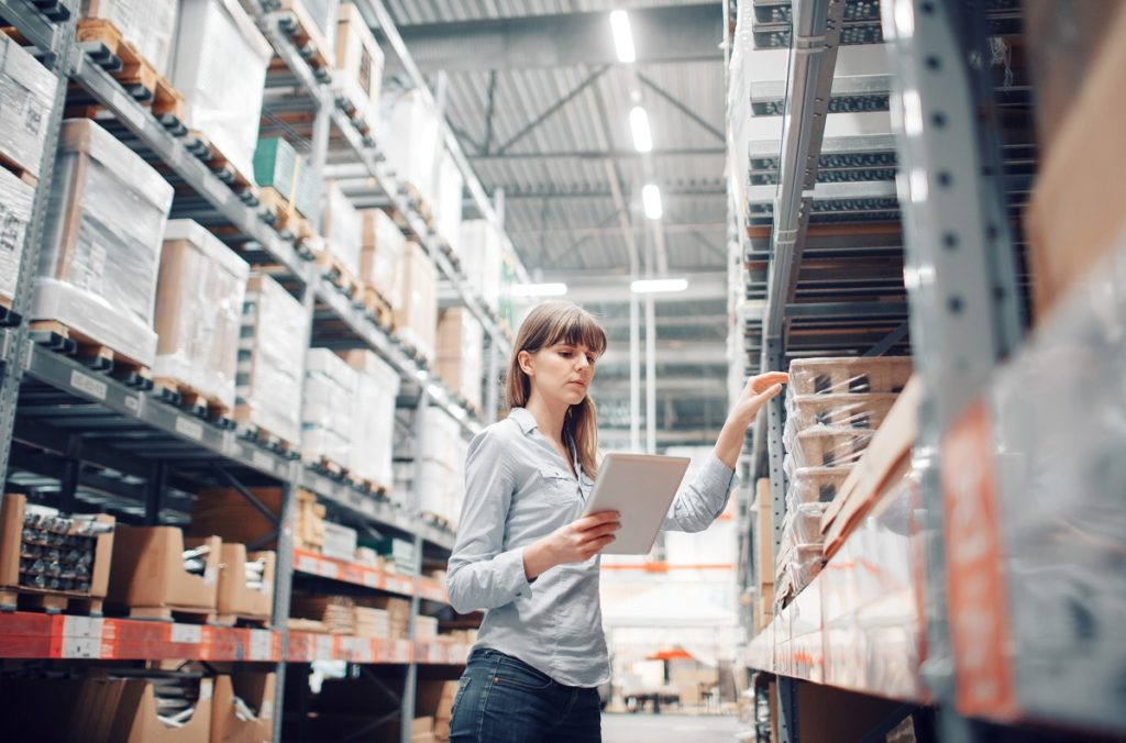 Woman checking inventory in warehouse