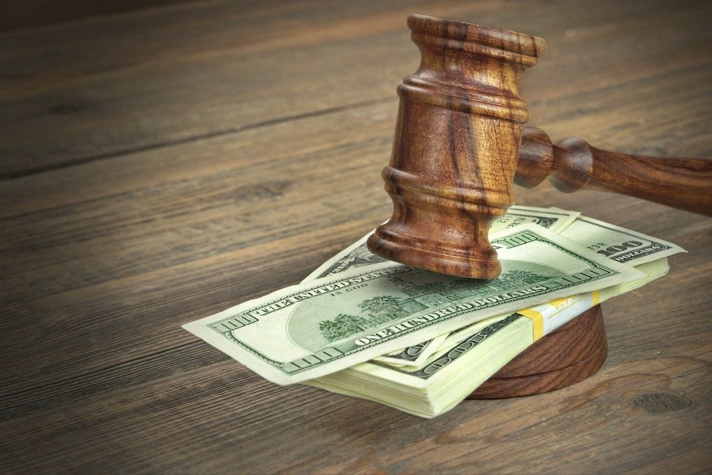 bail bonds concept with gavel and money