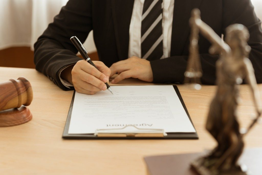 lawyer signing an agreement