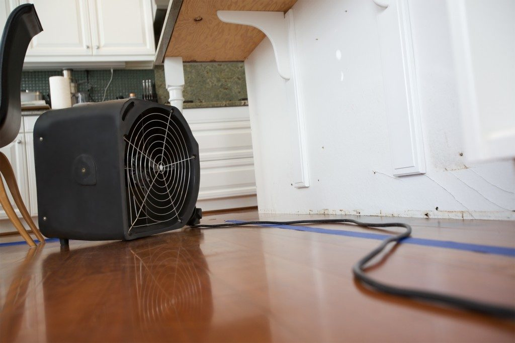 Using dehumidifier on damaged floor and furniture