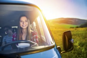 Woman happily driving van