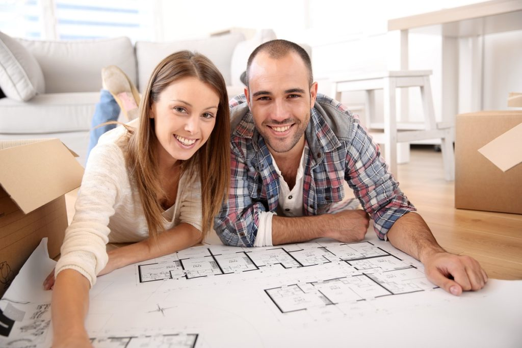 couple looking at their house floor plan