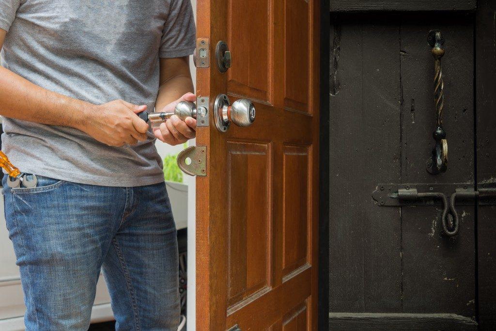 Repairman checking the doorknob