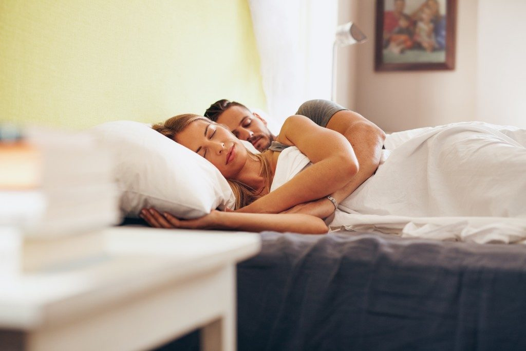 Couple cuddling while sleeping