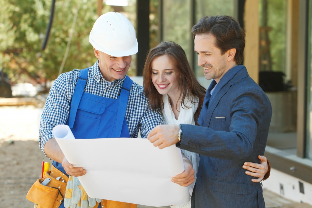 Contractor showing couple a blueprint