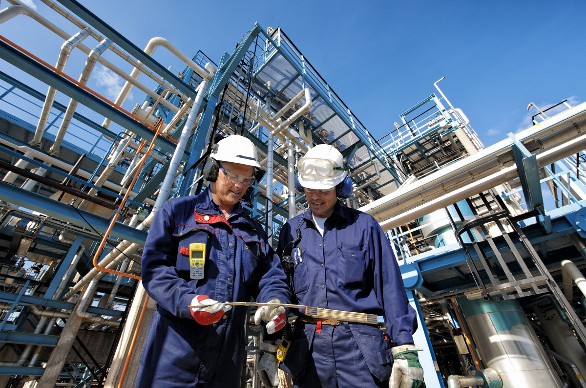 Oil plant workers wearing safety gear