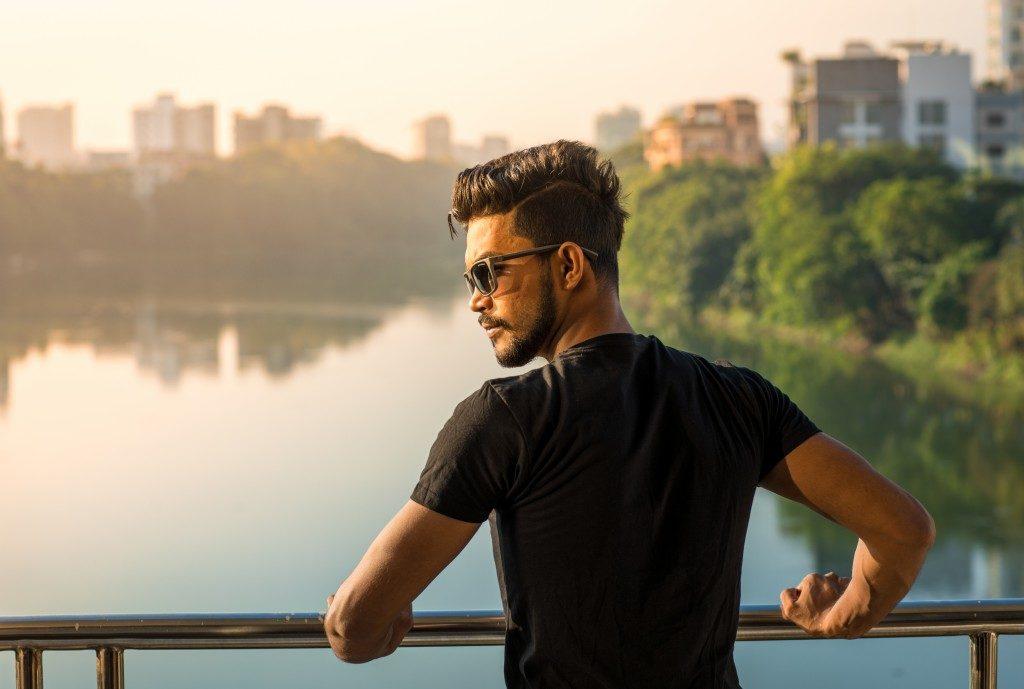 man beside lake