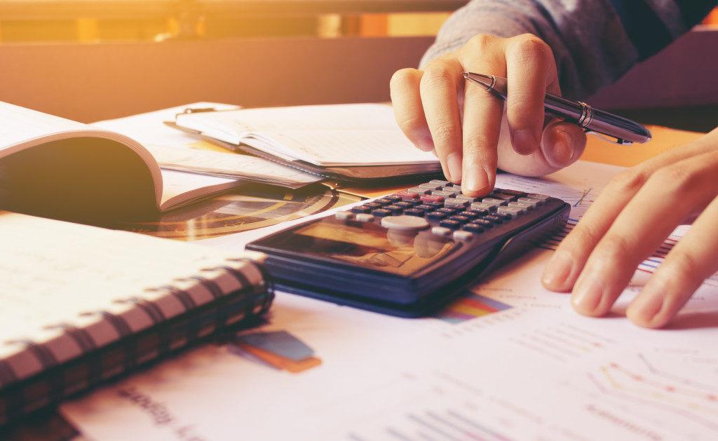 person calculating bills