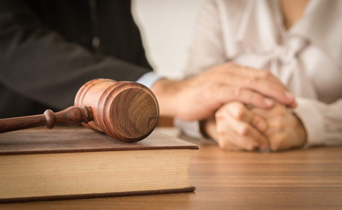 gavel in front of a man holding woman