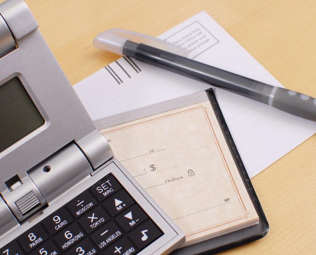 calculator, check and pen