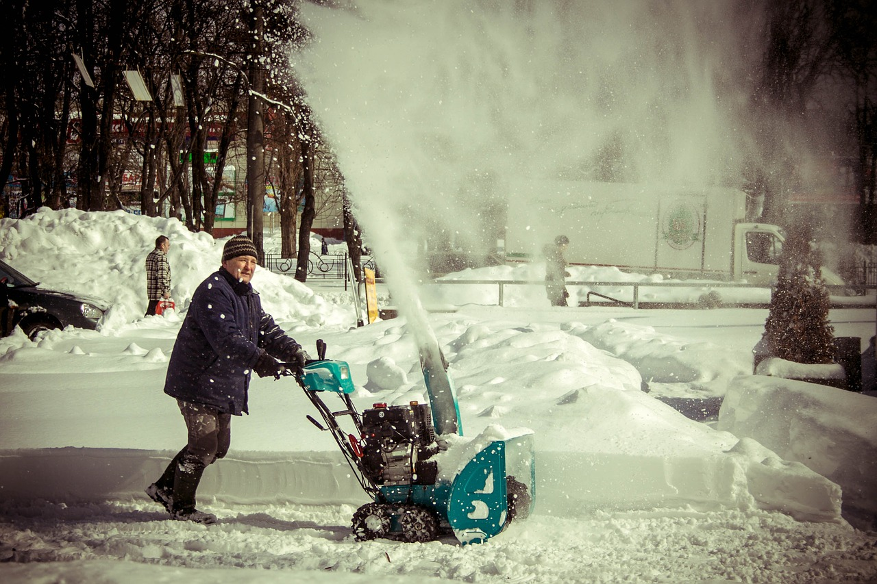 man clearing up the snow