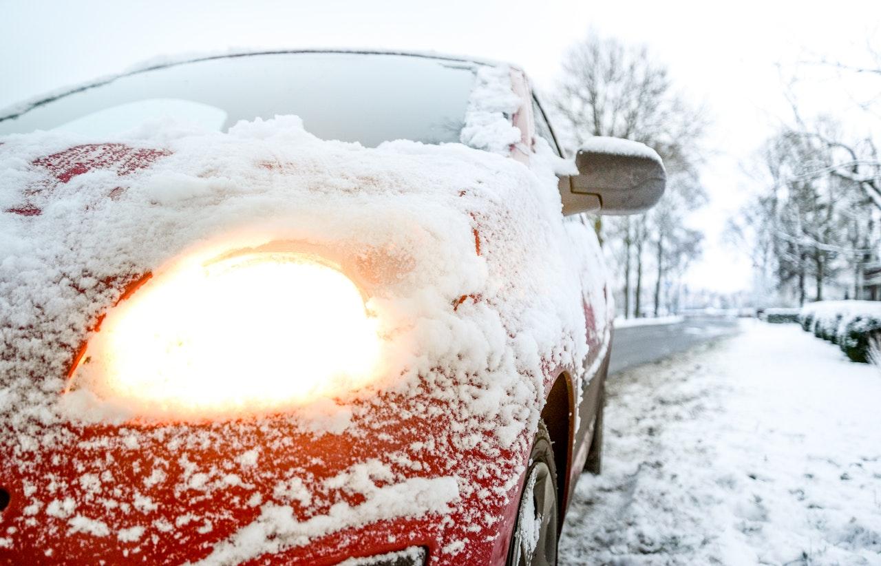 sedan covered in snow