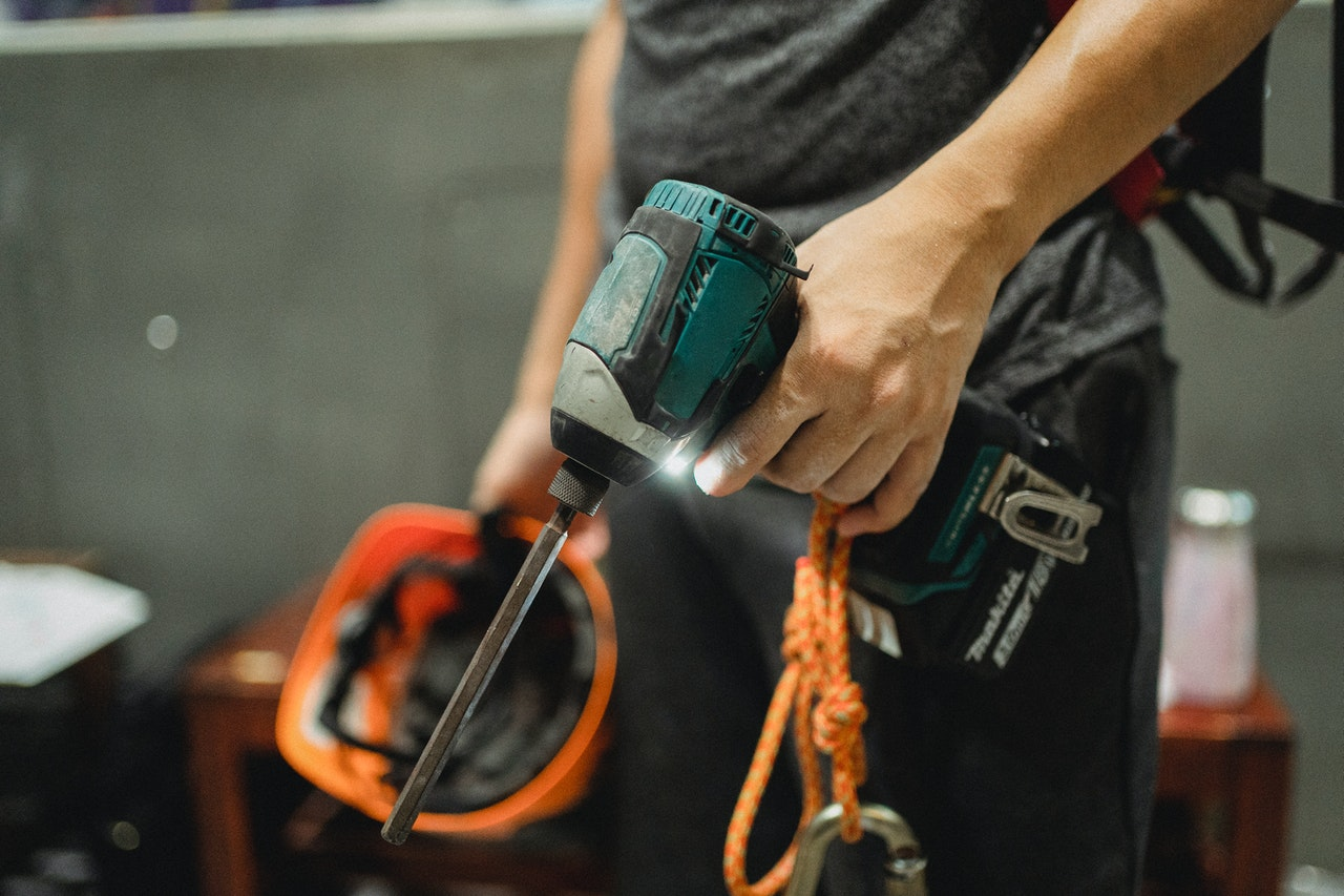 person holding a drill