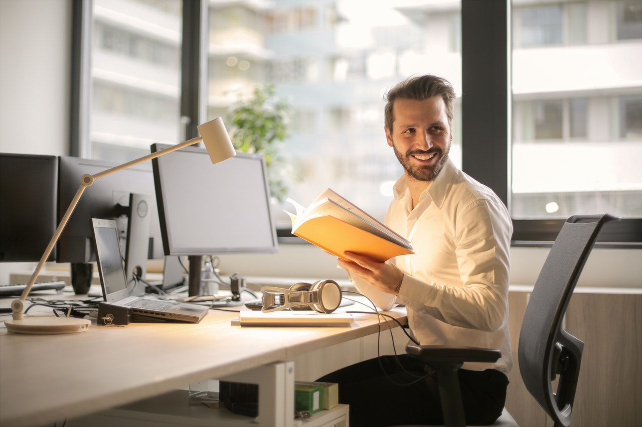 man sitting by his desk