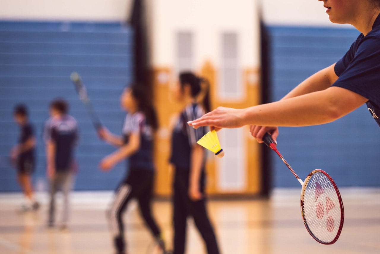 people having a match of badminton