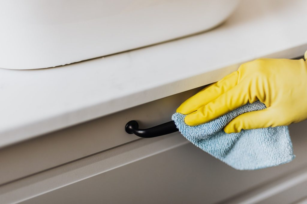 person cleaning a handle