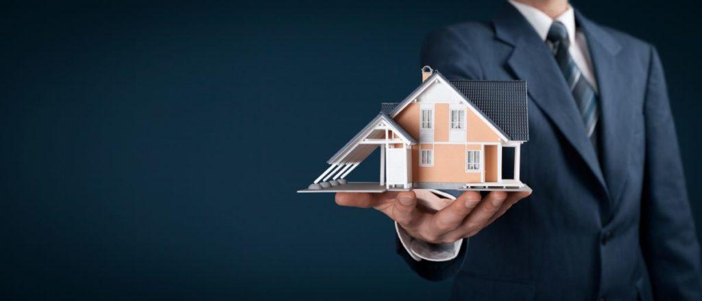 holding miniature house model