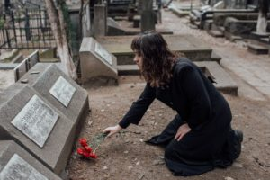 woman at a cemetery