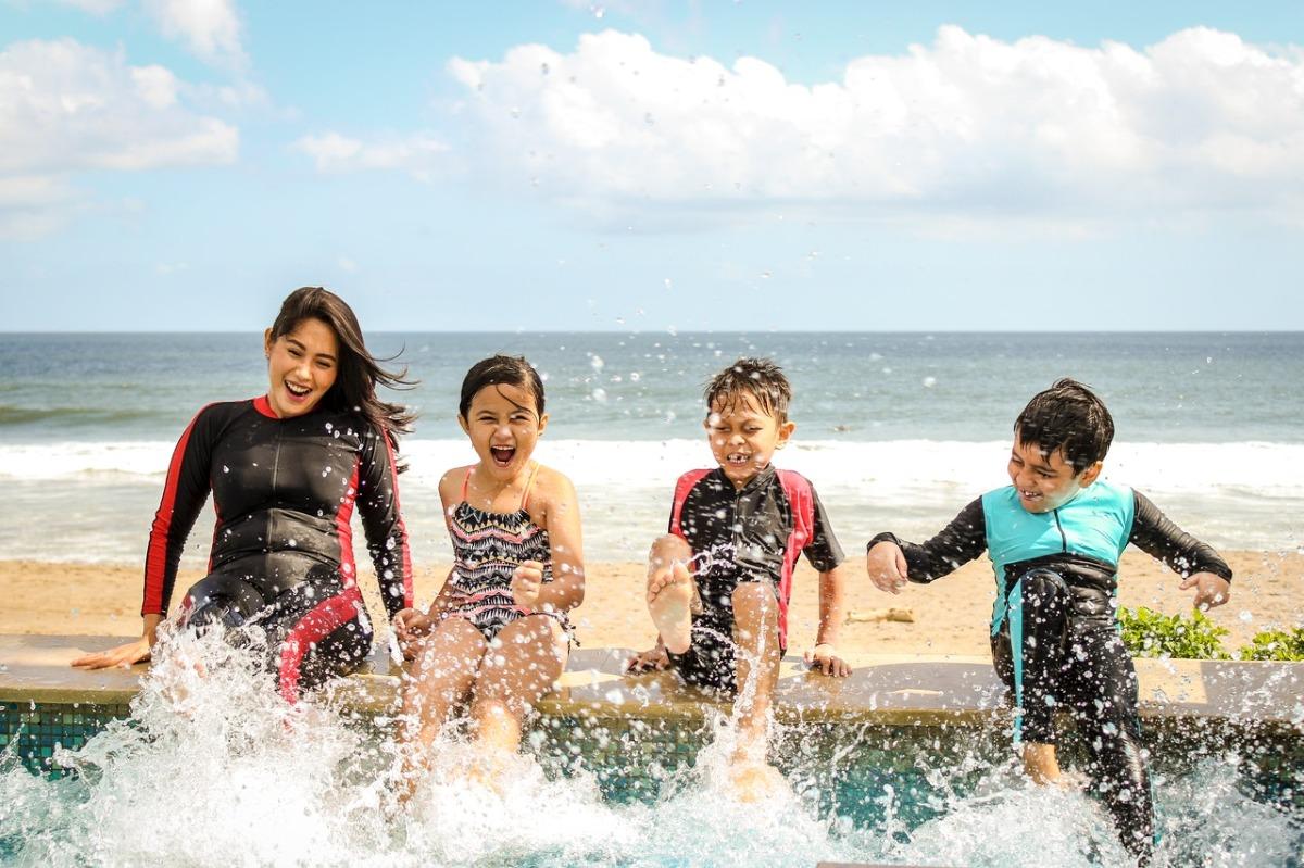family splashing water