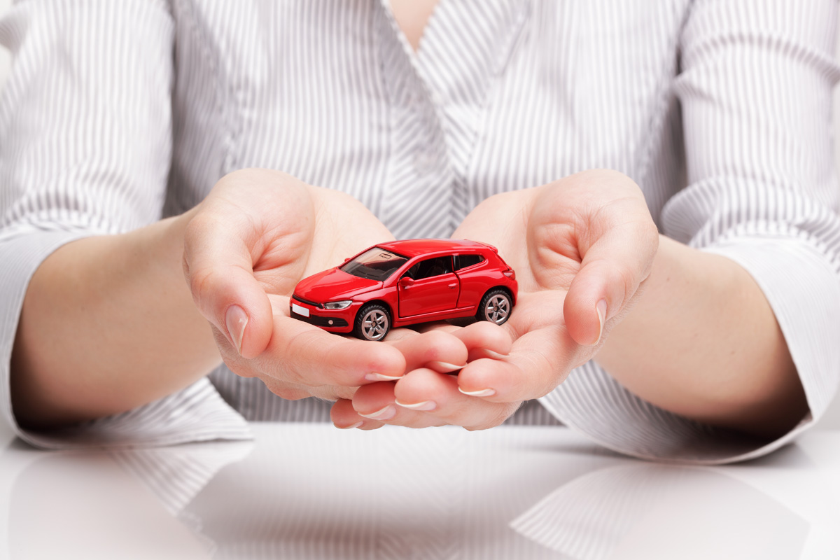holding car