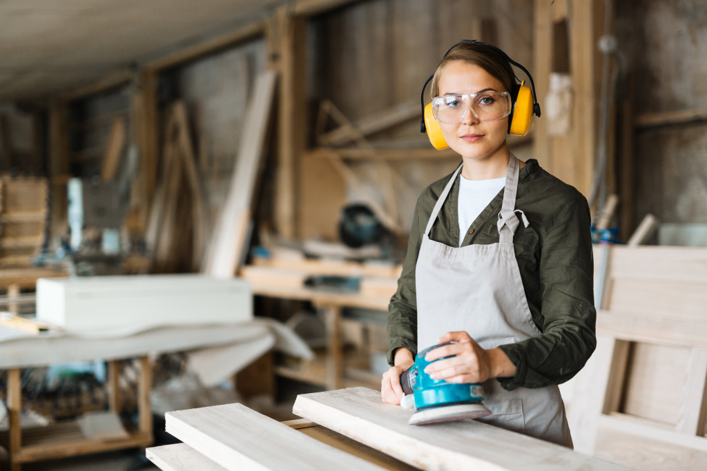 woman working ad a wood shop