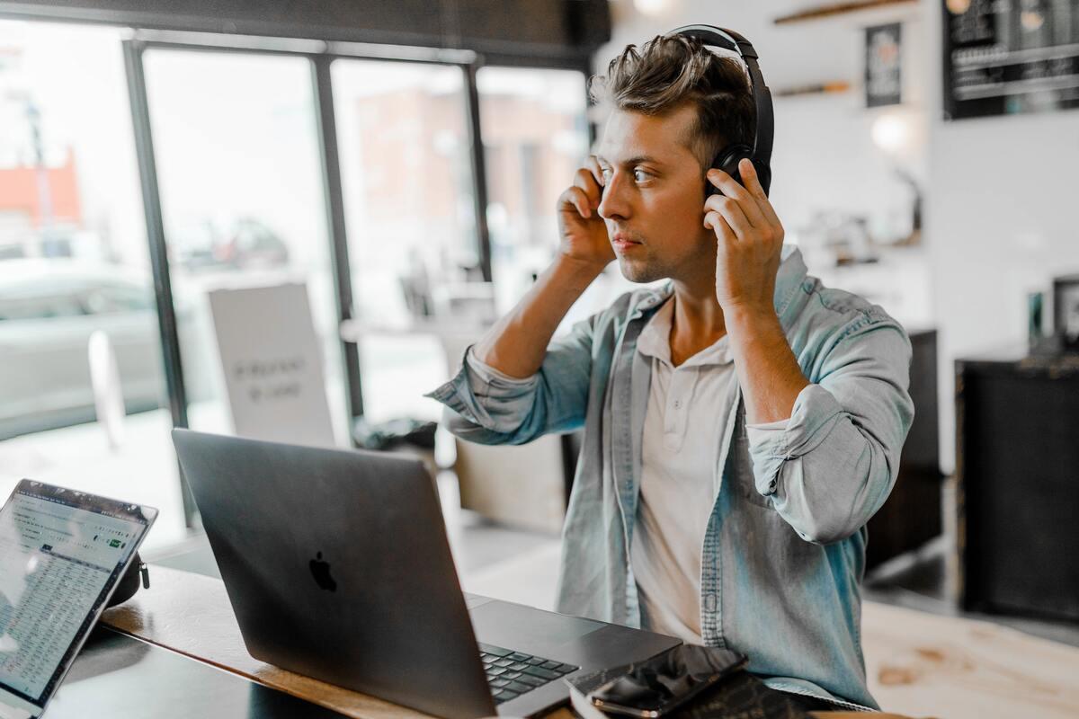 man putting on headphones
