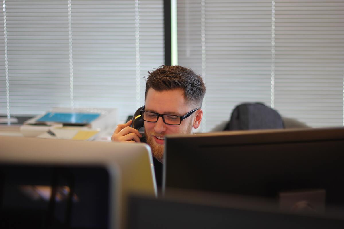 man on the phone while working