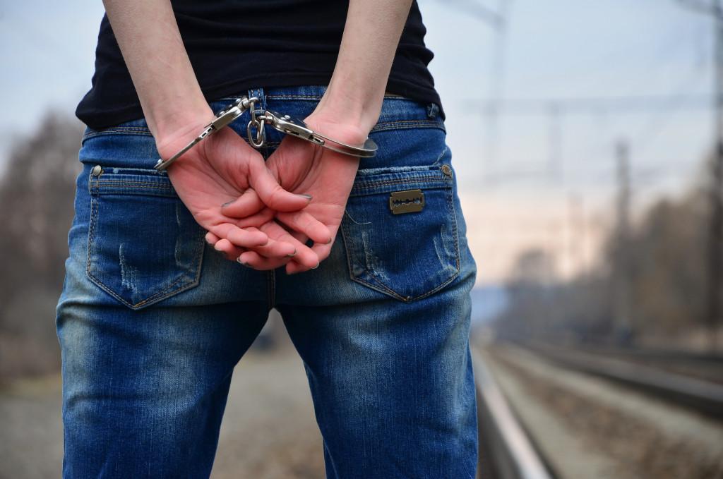 hand cuffed man