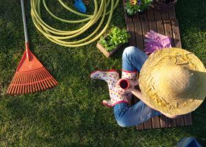 gardener cleaning lawn